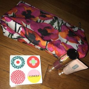 Three piece Clinique set with cosmetic bag